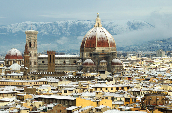 Cathedral Santa Maria del Fiore (Duomo) and giottos bell tower (campanile), in winter with snow in Florence, Tuscany, Italy.
