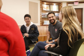 students smiling and participating in intergroup dialogue