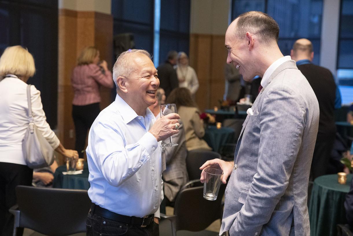 Larry Wok '69, M.B.A.'80 chats with Development Officer Lee Warnecke.