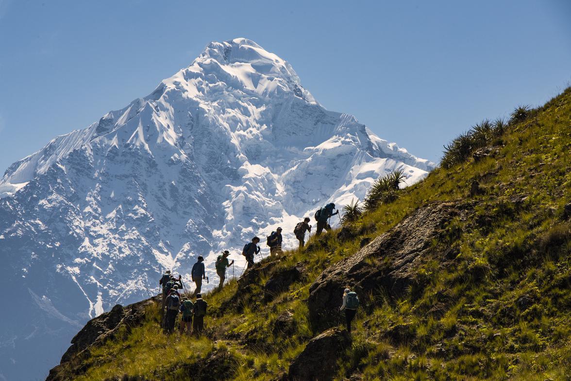 Students climbing a mountain in Peru