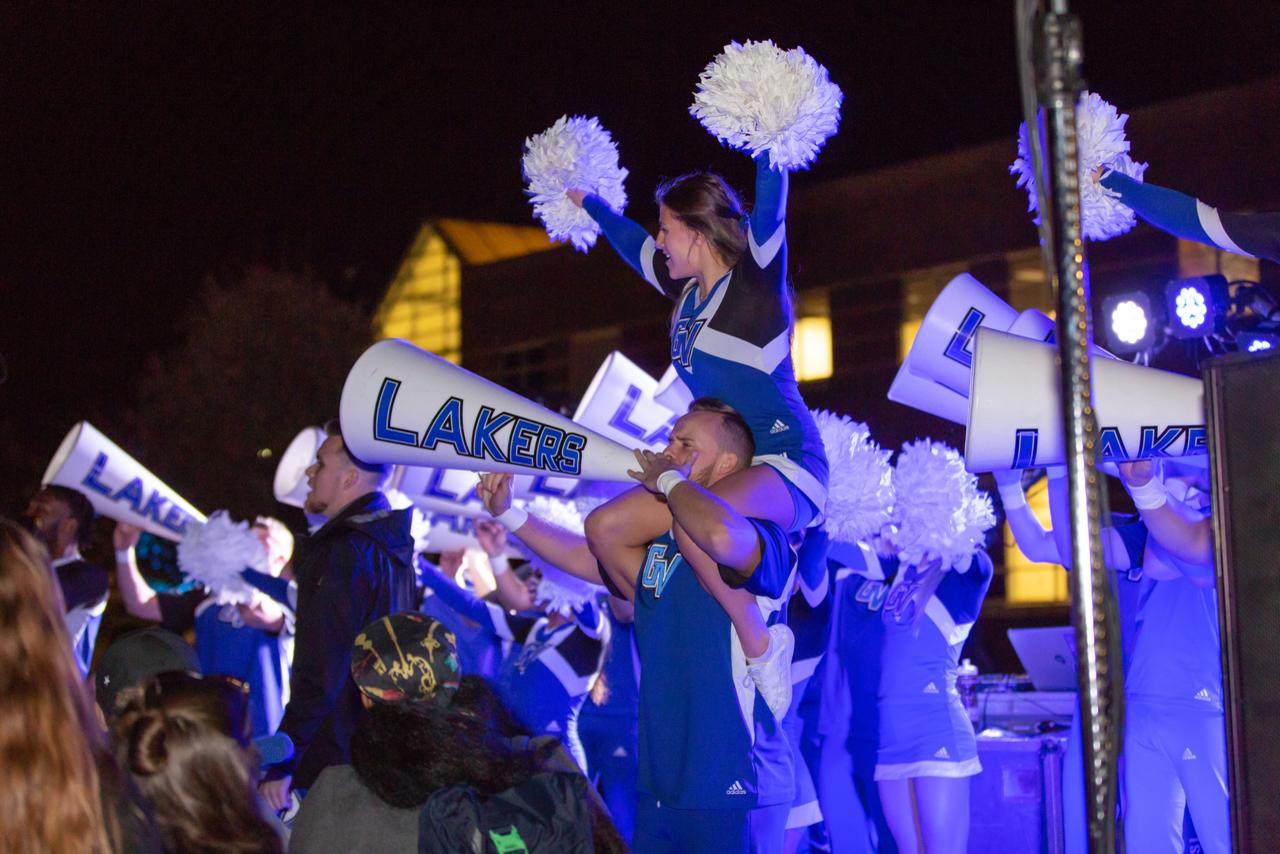 GV cheer hyping up the crowd at homecoming.