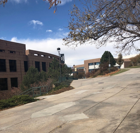 UCCS campus, paved walkway on hill with buildings along side