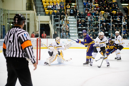 "Link to Michigan Tech Athletics' article ""Mavericks edge Huskies Saturday in WCHA action"""