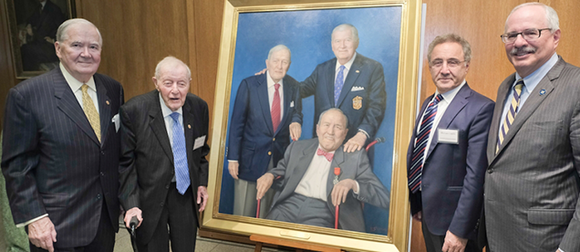 Robert G. Perry, Albert H. Small, Michael Caplin and President Thomas LeBlanc with a portrait unveiled at the symposium in honor of World War II veteran Mortimer M. Caplin.