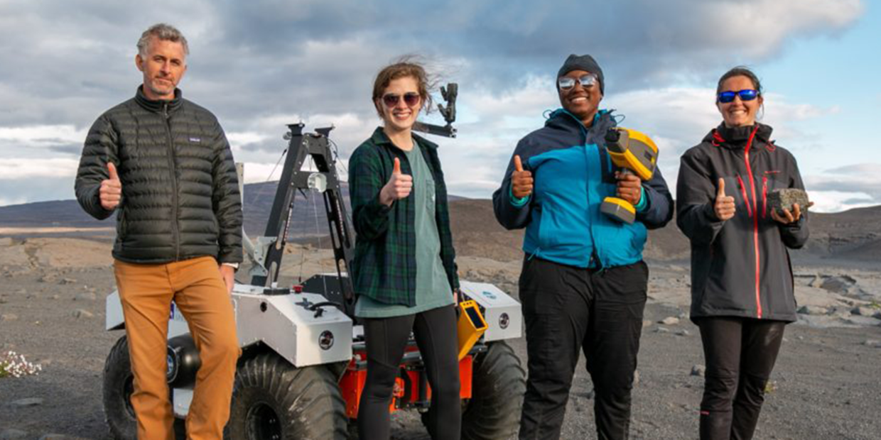 Photo of the Texas A&M team of researchers in Iceland, with the rover.