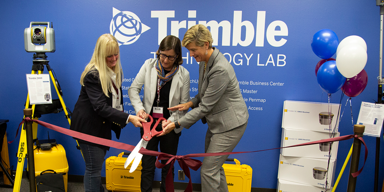 A photo of the ribbon cutting ceremony at the Trimble Technology Lab at Texas A&M