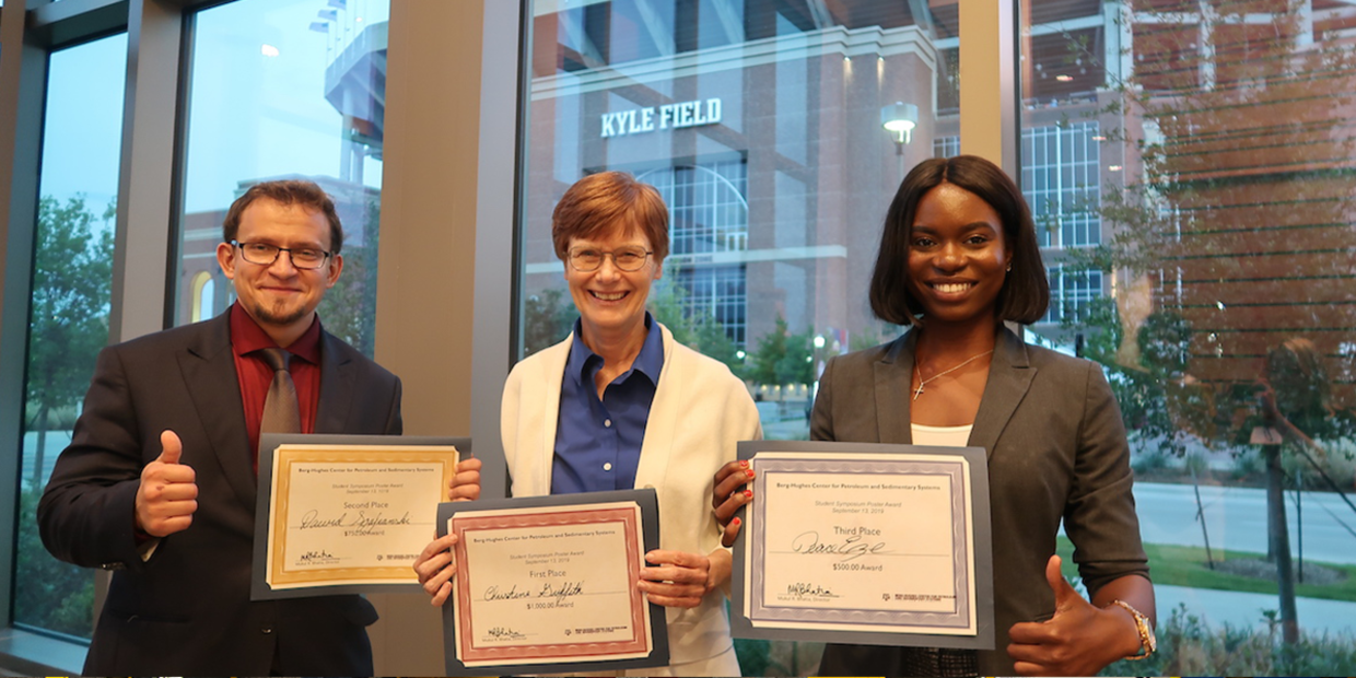 Geology and geophysics graduate students Dawid Szafranski, Christine Griffith, and Peace Eze (left to right) were awarded first, second, and third prizes, respectively, for best research posters at the Berg-Hughes 10th annual Research Symposium. (Photo by Ali Snell.)