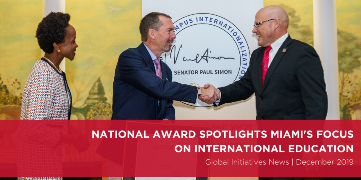 National Award Spotlights Miami's Focus on International Education, Global Initiatives News | December 20109, President Crawford shaking hands with NAFSA staff member and accepting award on stage