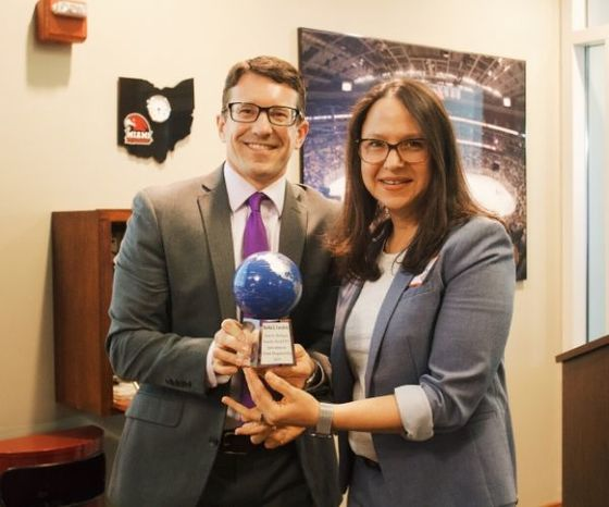 Ryan Dye and Martha Castaneda holding an award