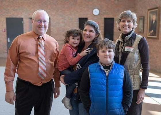 Image of Shawn Fenton, Tamara Burchel, Tamara's children Benjamin and Evie, and Dean Cathy Bishop-Clark