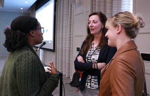 Dr. Morag Kersel (center) speaks with Miami students