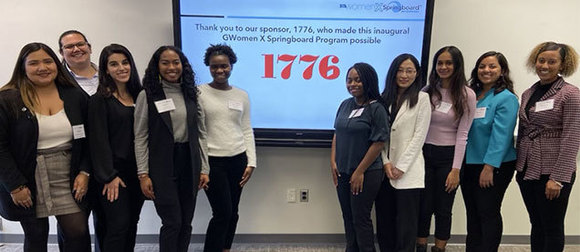 Evelyn Ramirez and other students stand in front of a projection screen