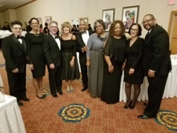 Pictured from left to right: People Inc. employees and supporters: Frank and Tanya Perri, Robert Bedigan, Rhonda Frederick, Sheldon and Quintella Cottrell, Wanda Watts, Barbara Johnson and Bradford Watts.