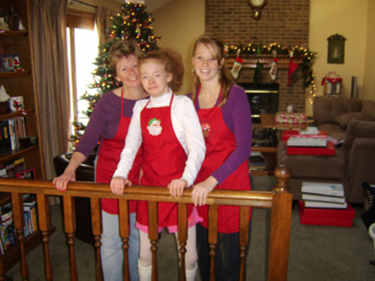 Barb, Laura and Andrea DeLong in their Christmas decorated living room.