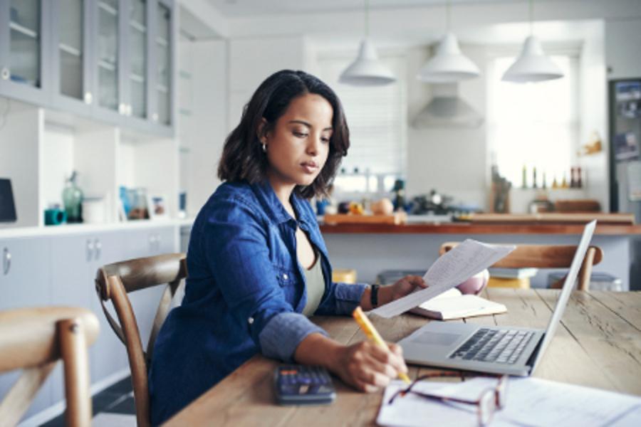 Women works on financial goals.