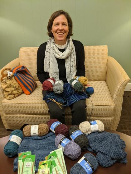 Jennifer Peace, Chaplain ad interim sitting with yarn and knitting needles