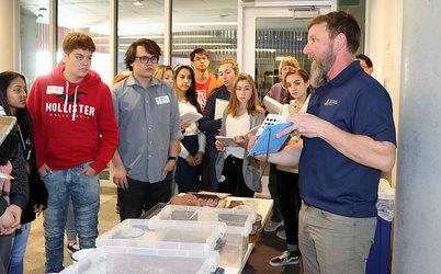 Dr. Craig Rasmussen demonstrating soil identification at the Envirothon Symposium