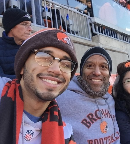 MUDEC student Quinton with his family at a Cleveland Brown's game