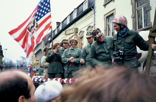 Carnival Parade in Diekirch with people dressed as soliders with an American flag