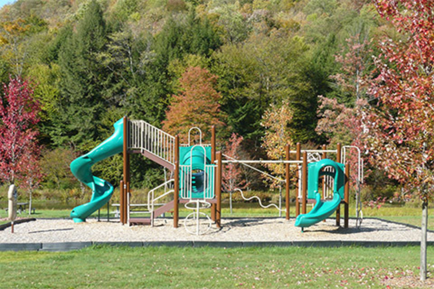 Playground equipment with trees in the background