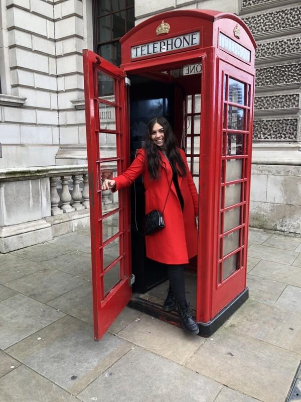 MUDEC gal in a telephone booth in London