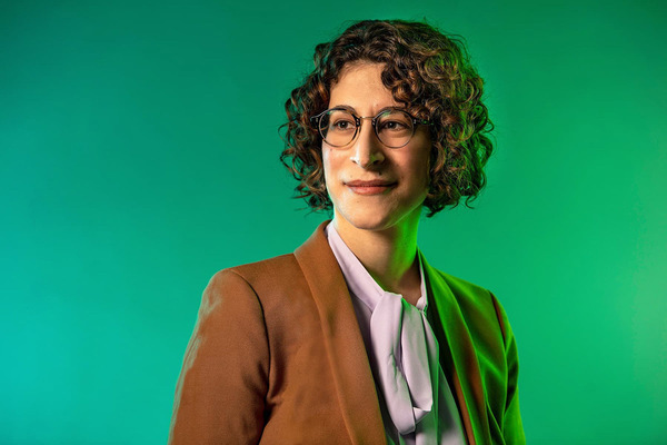 Photo of Sara Bernstein, the Thomas J. and Robert T. Rolfs Associate Professor of Philosophy. She is pictured with a tan suit.