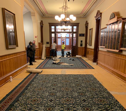 Image of carpet being installed in main building.