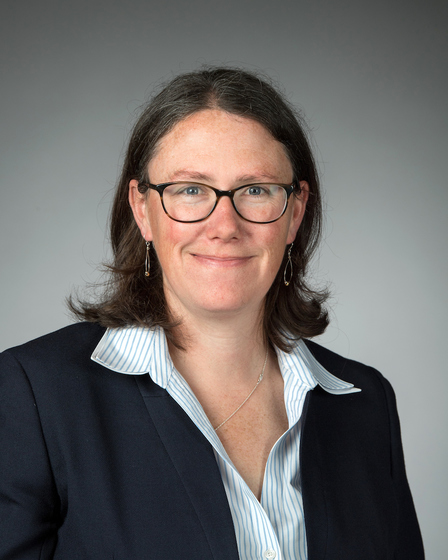 Pictured is Meghan Sullivan, professor of philosophy and the Rev. John A O'Brien Collegiate Chair. She is wearing a dark suit with a light blue blouse.
