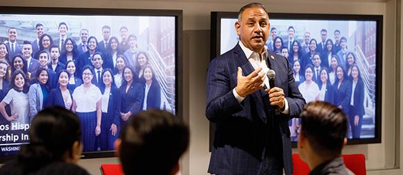 Gil Cisneros speaking at event
