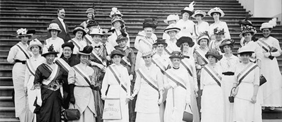 Group of suffragettes in white on steps