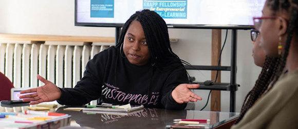 Zaniya Lewis speaking during a meeting