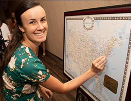 Student pinning a location on a map