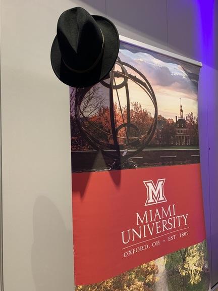 Dean Leterre's hat on the MUDEC banner