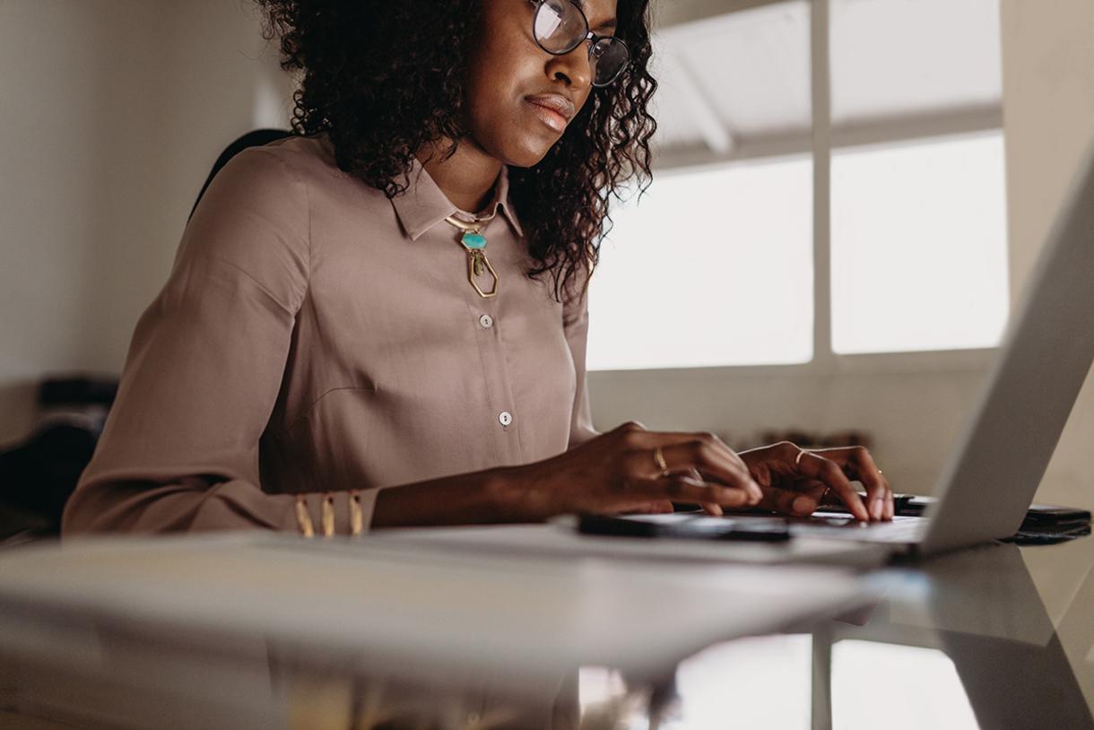 Woman sitting at laptop computer working