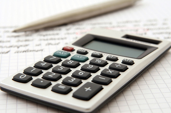 Photo of calculator and pen on a ledger