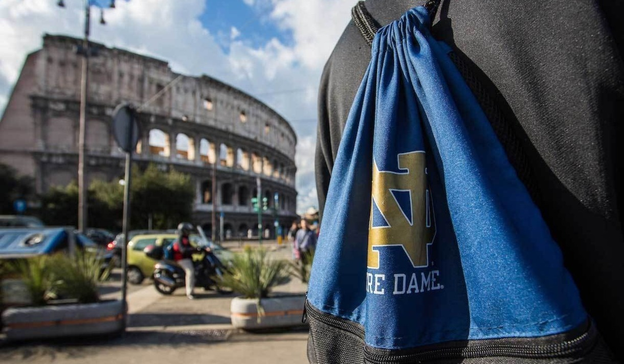 Image of the Coliseum in Rome, and a student with a Notre Dame sling bag.