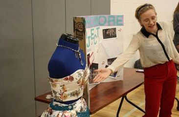 A Palisade High School sophomore shows off her project, a designer outfit.