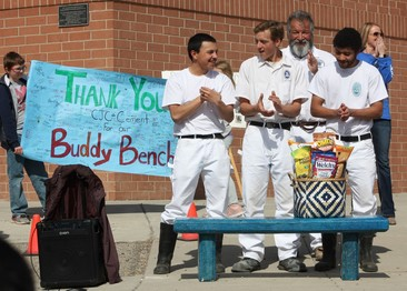 Collbran Job Corps students clap as the buddy bench they built is dedicated on the Thunder Mt. playground.
