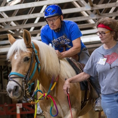 TEC participant during a therapeutic riding lesson.