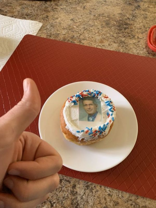 Connor Manley giving a thumb's up to his donut