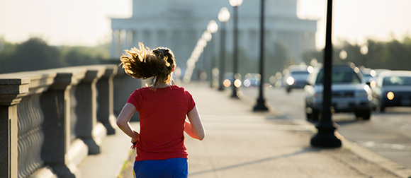 Jogger running across memorial bridge in washington DC