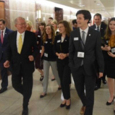 Washington Program Students Walking with Senator Lamar Alexandar
