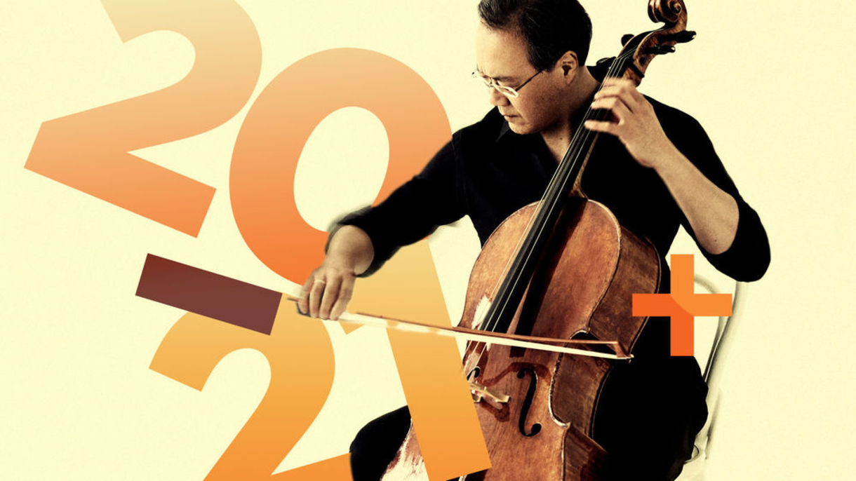 Photo of a cellist playing with 2021 graphically in the image.