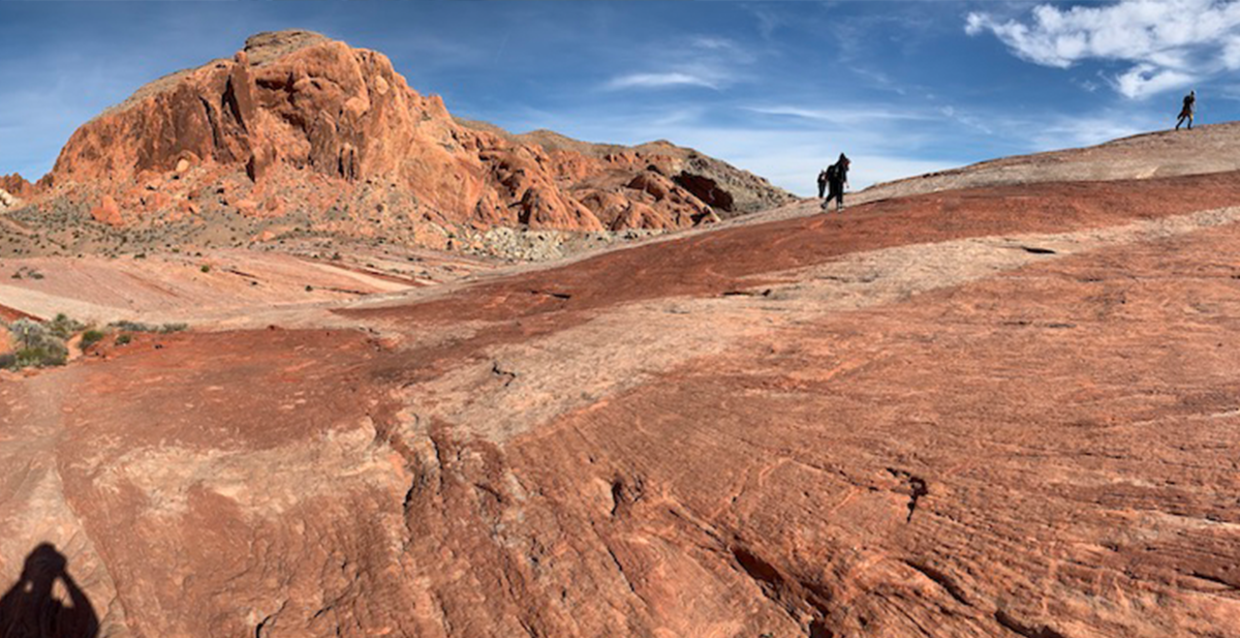 Panoramic image of students atop the Aztec sandstone in Valley of Fire State Park, NV. (Photo courtesy of Dr. Brian Balta.)