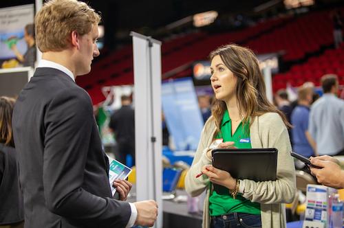 Student talks with woman at career fair