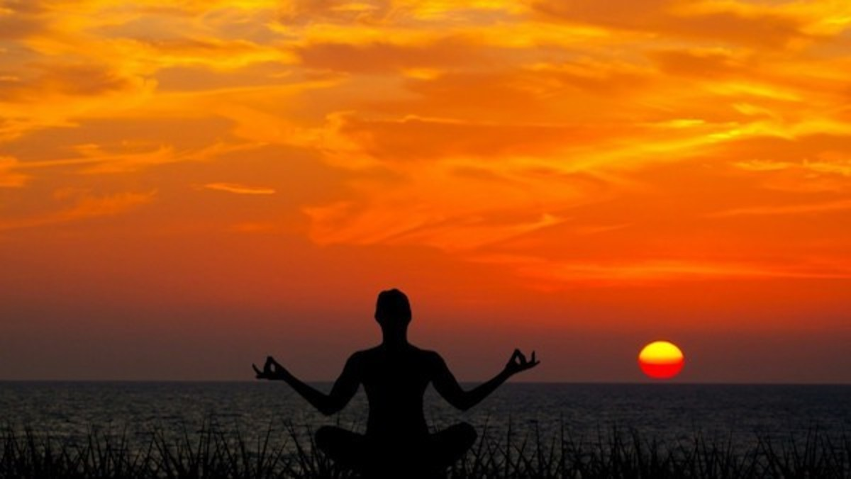 yoga silhouette at sunset