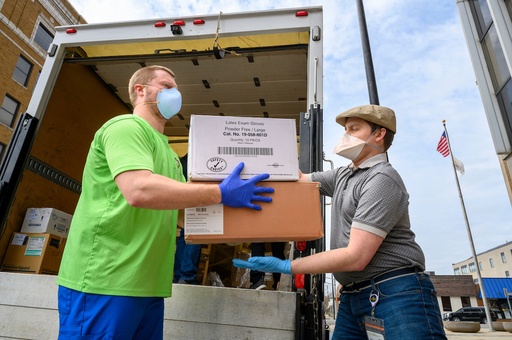 Workers unload a truck full of personal protective equipment (PPE) from Notre Dame to the county.