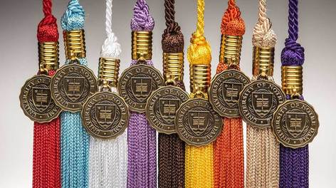 Photo of multicolored tassels that represent different degrees.