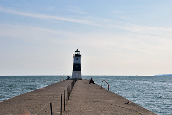 The Presque Isle lighthouse on the end of a concrete pier