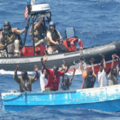 Group of Pirates being followed by US Coast Guard